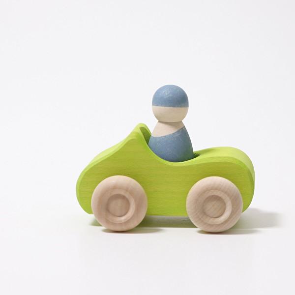 Imagen de Coche verde pequeño con un pasajero